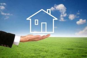 Hand mit Haus / mit Landschaft